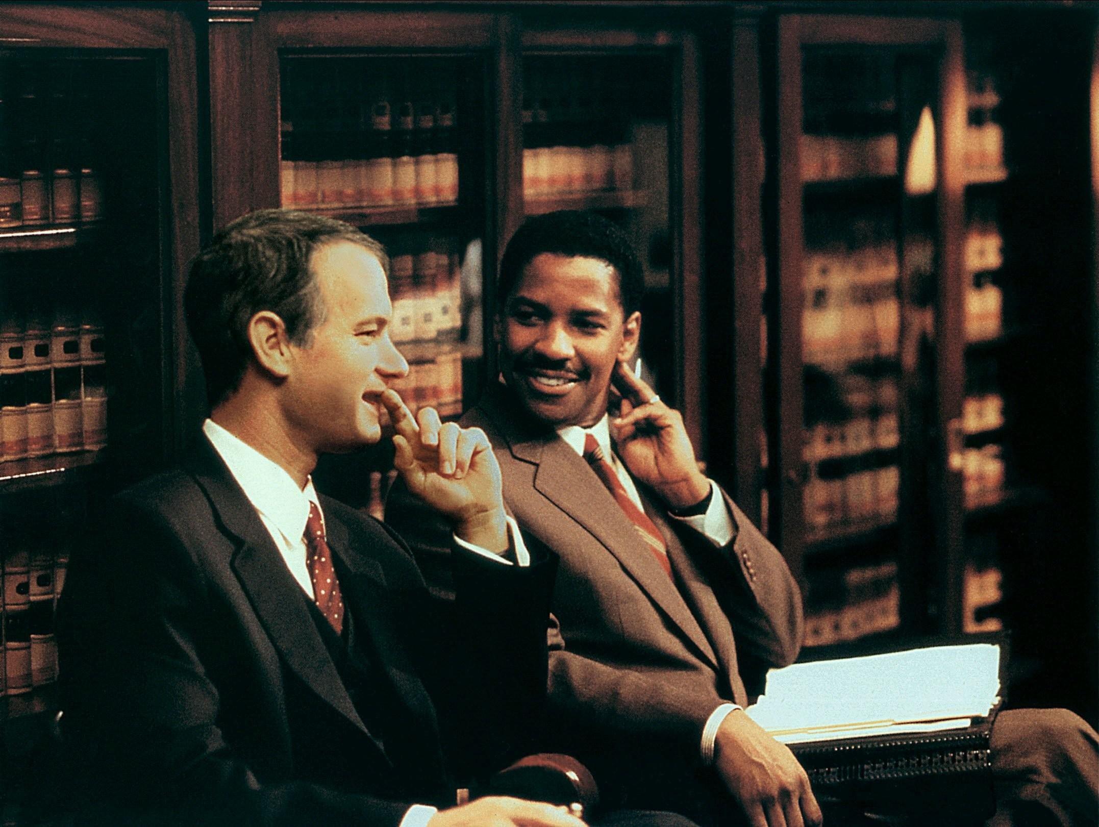 Tom Hanks and Denzel Washington's characters sit together