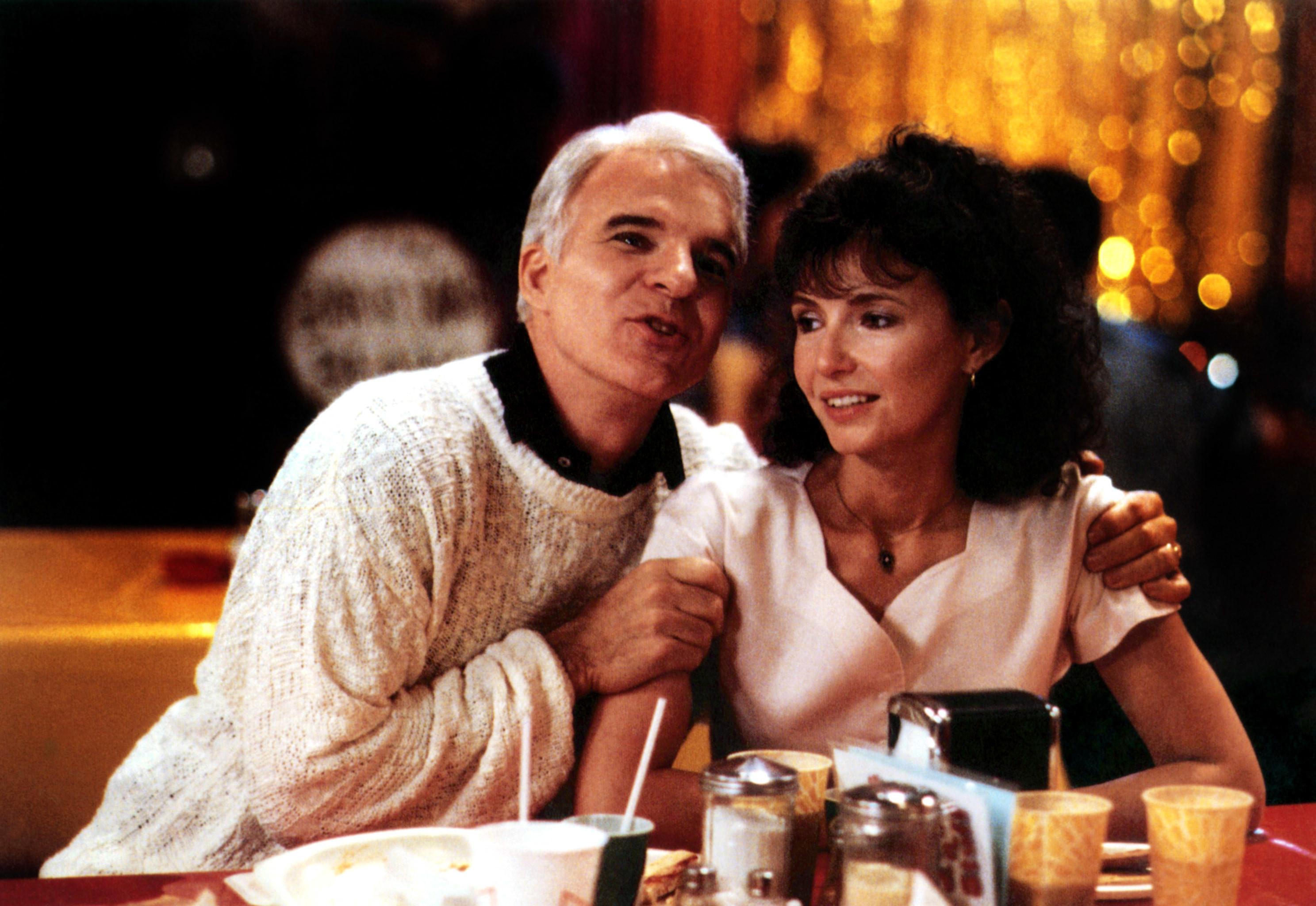 Steve Martin as Gil embracing Mary Steenburgen as Karen at a table at a restaraunt