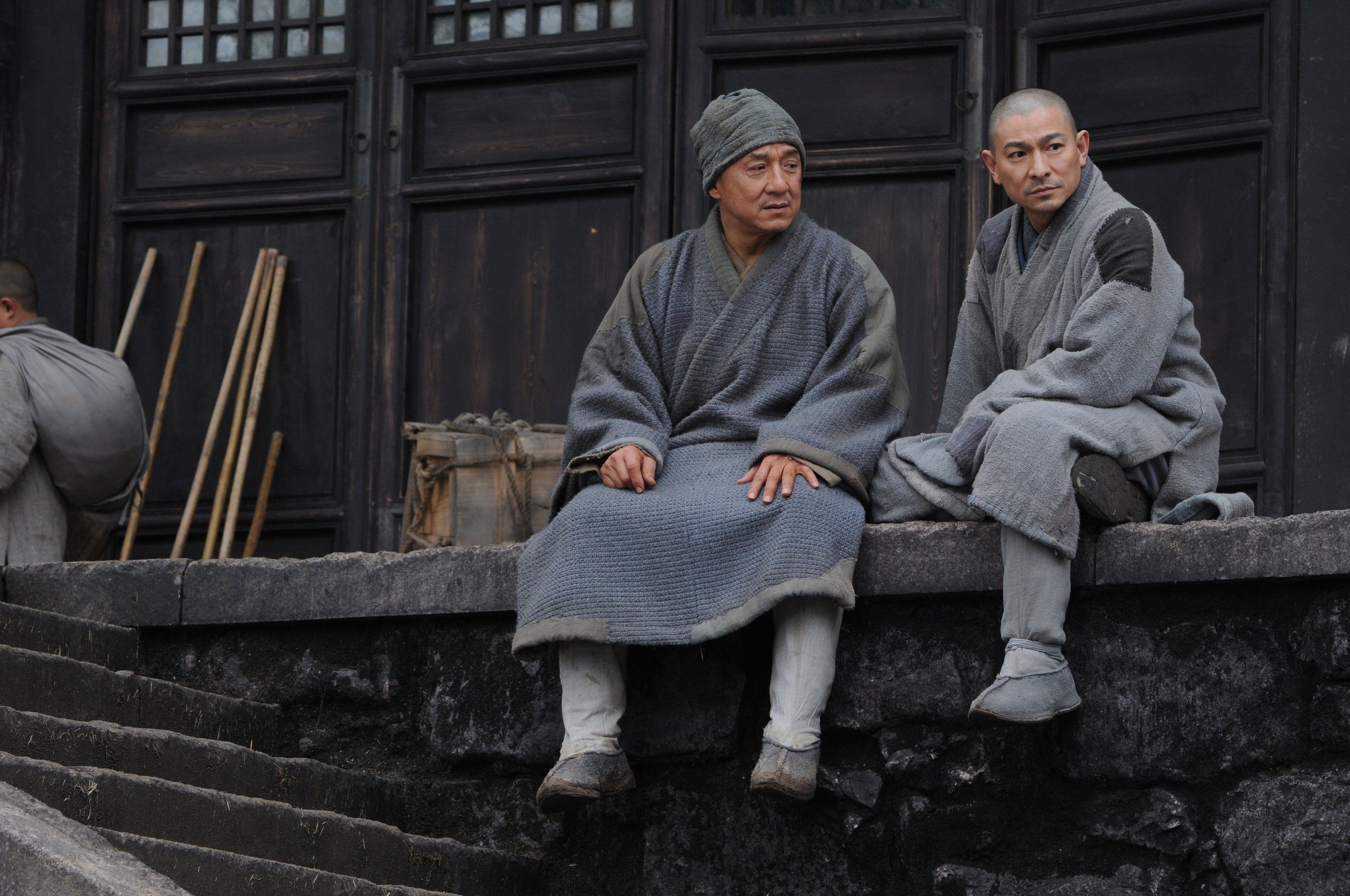 Jackie Chan and Andy Lau's characters sitting together