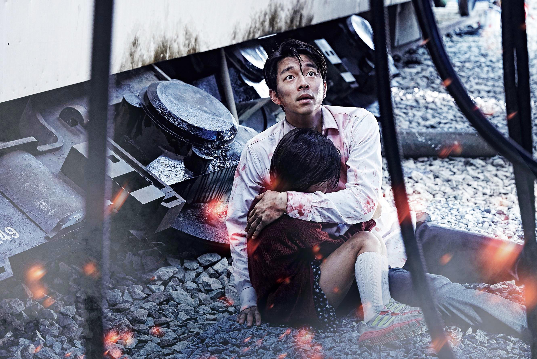 Seo Seok-woo and his daughter huddle together