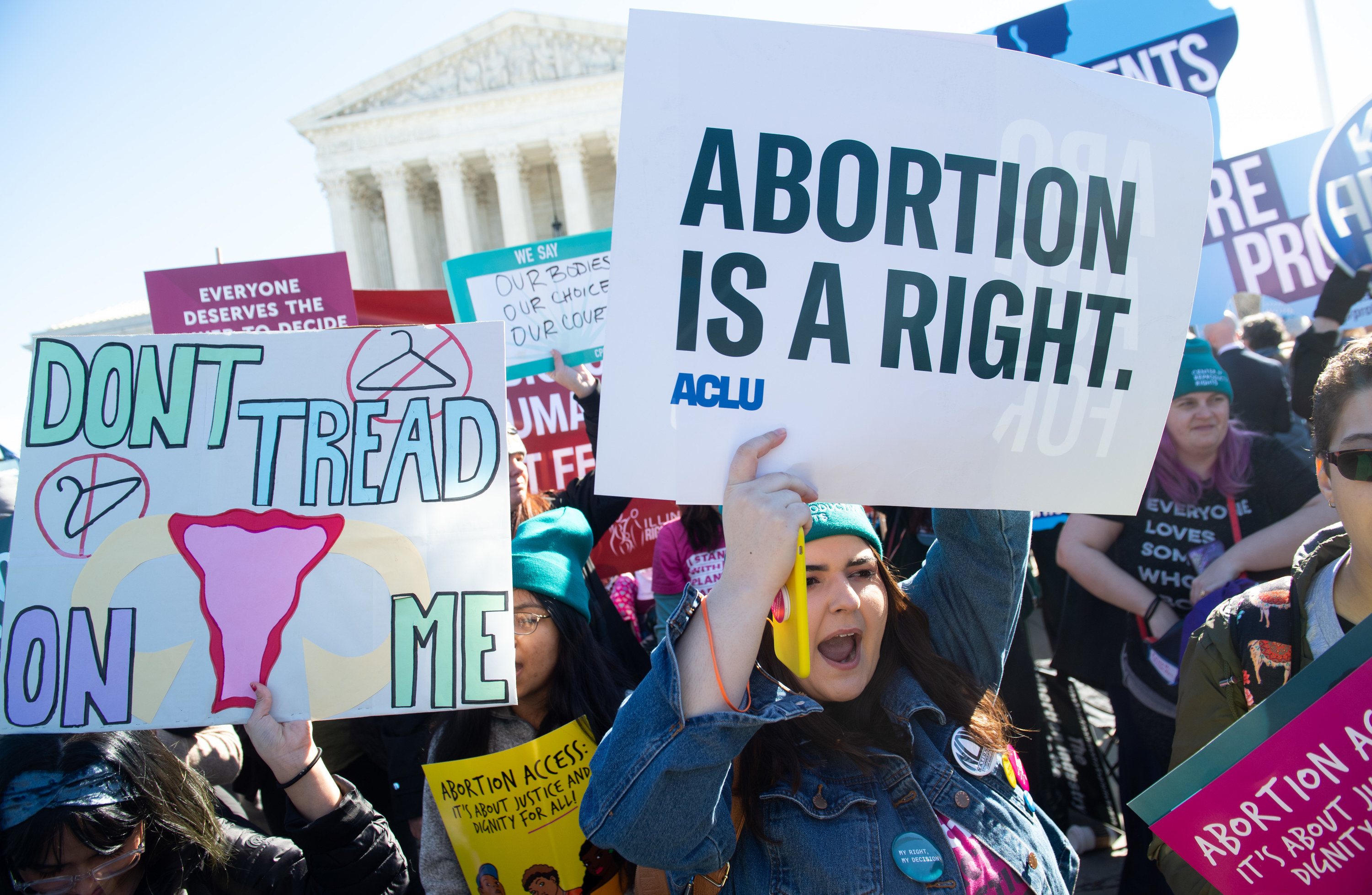 Pro-choice activists supporting legal access to abortion protest during a demonstration outside the US Supreme Court in Washington, DC, March 4, 2020