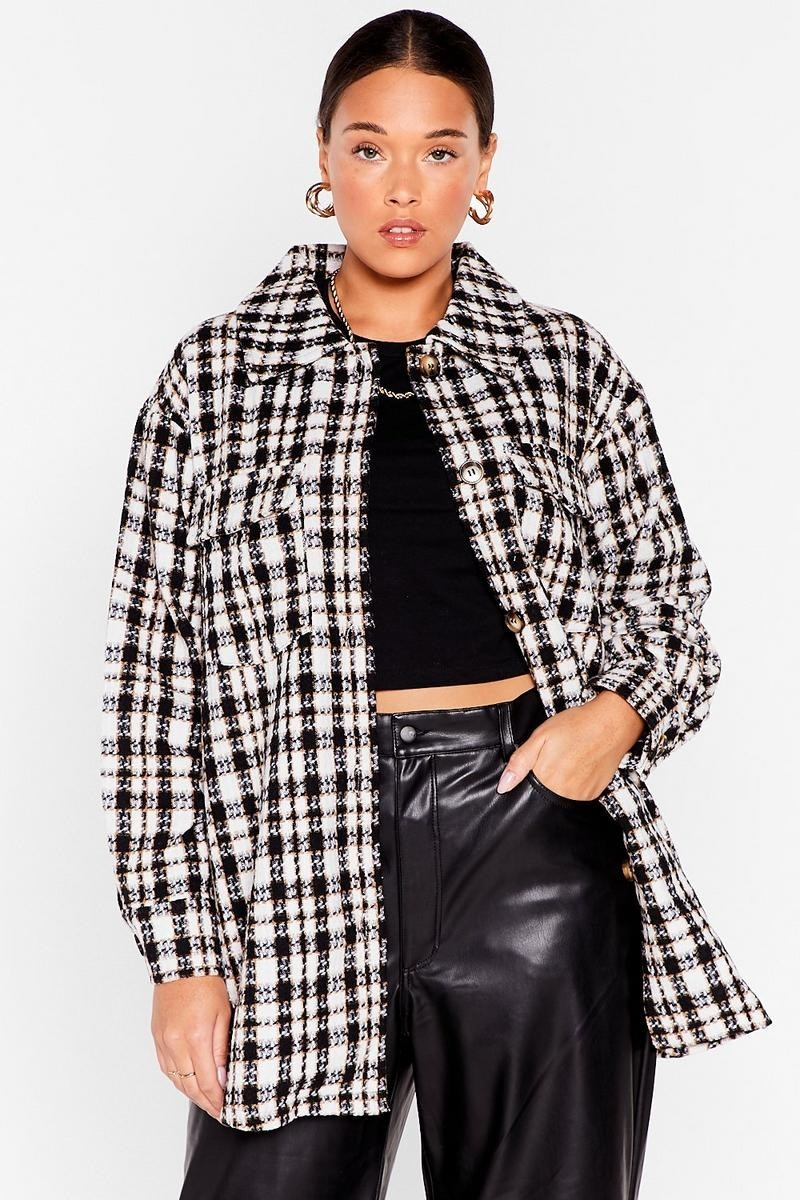 model wearing the white and black plaid overshirt