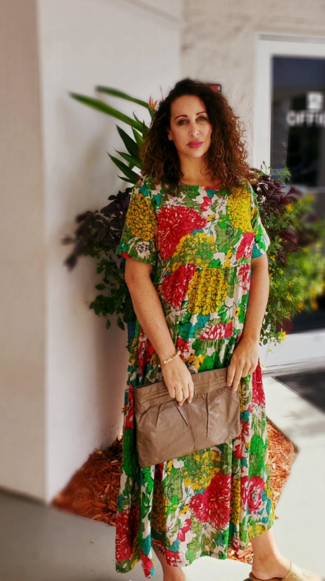 Reviewer wearing the red and greenBohemian floral dress dress