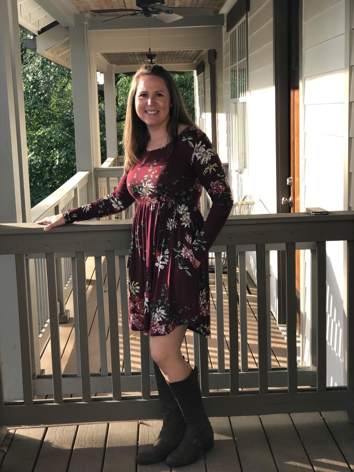 Reviewer wearing the floral winelong-sleeve casual dress