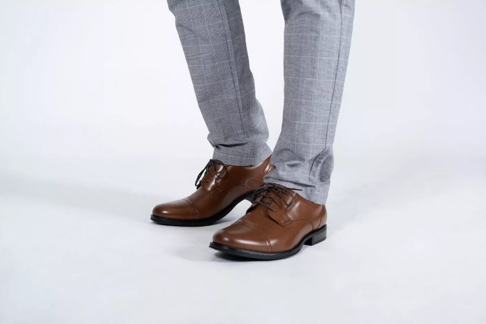 Brown dockers shoes worn with gray pants