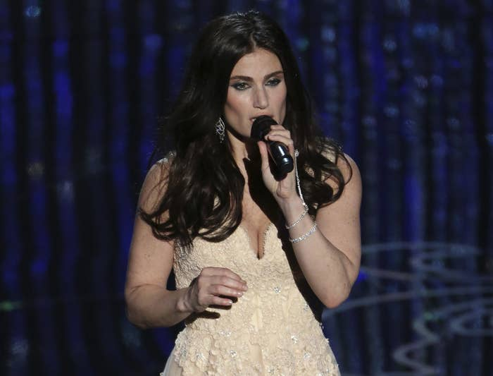 Idina performs in a cream colored dress at the Oscars