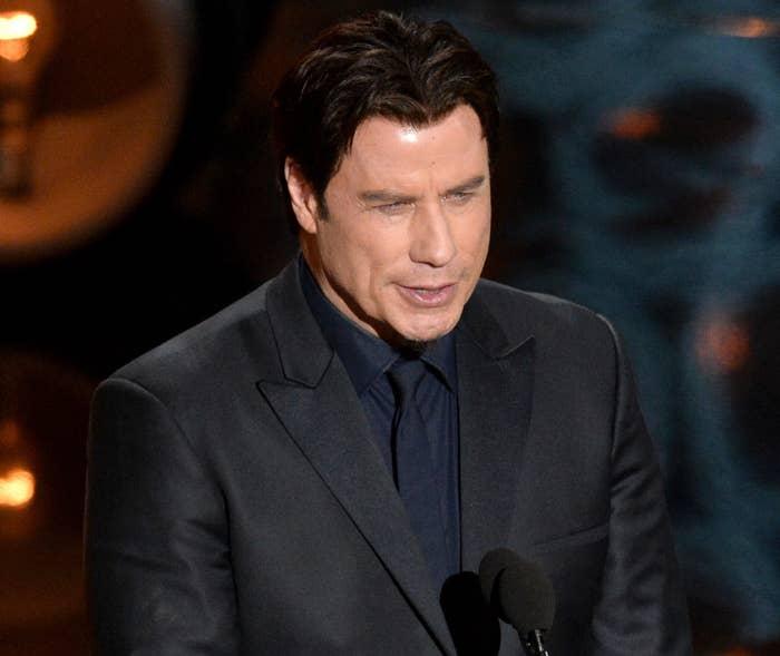 John speaks on stage at the Oscars