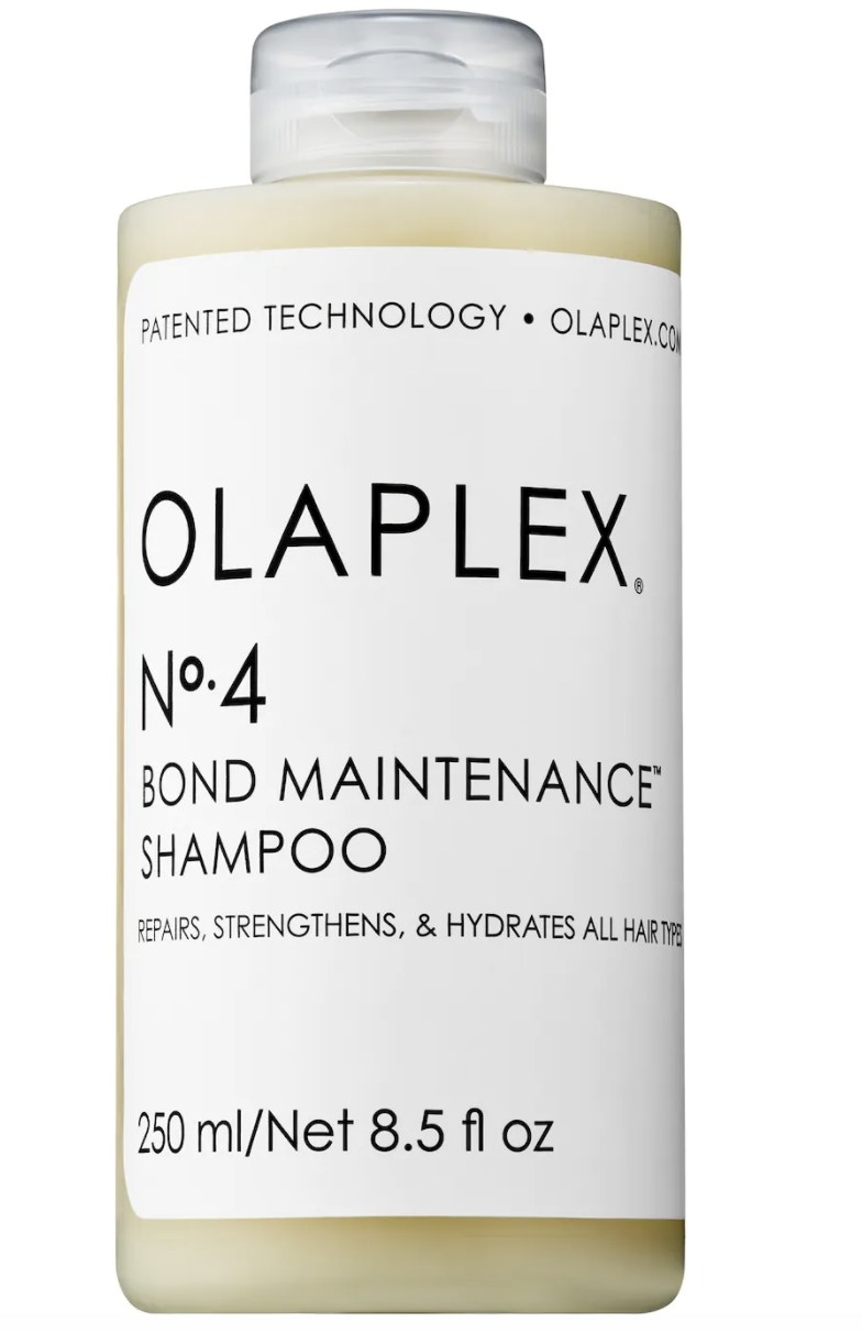 """The clear bottle has a white label that says """"OLAPLEX No. 4 BOND MAINTENANCE SHAMPOO"""" and is full of a cream-colored liquid"""