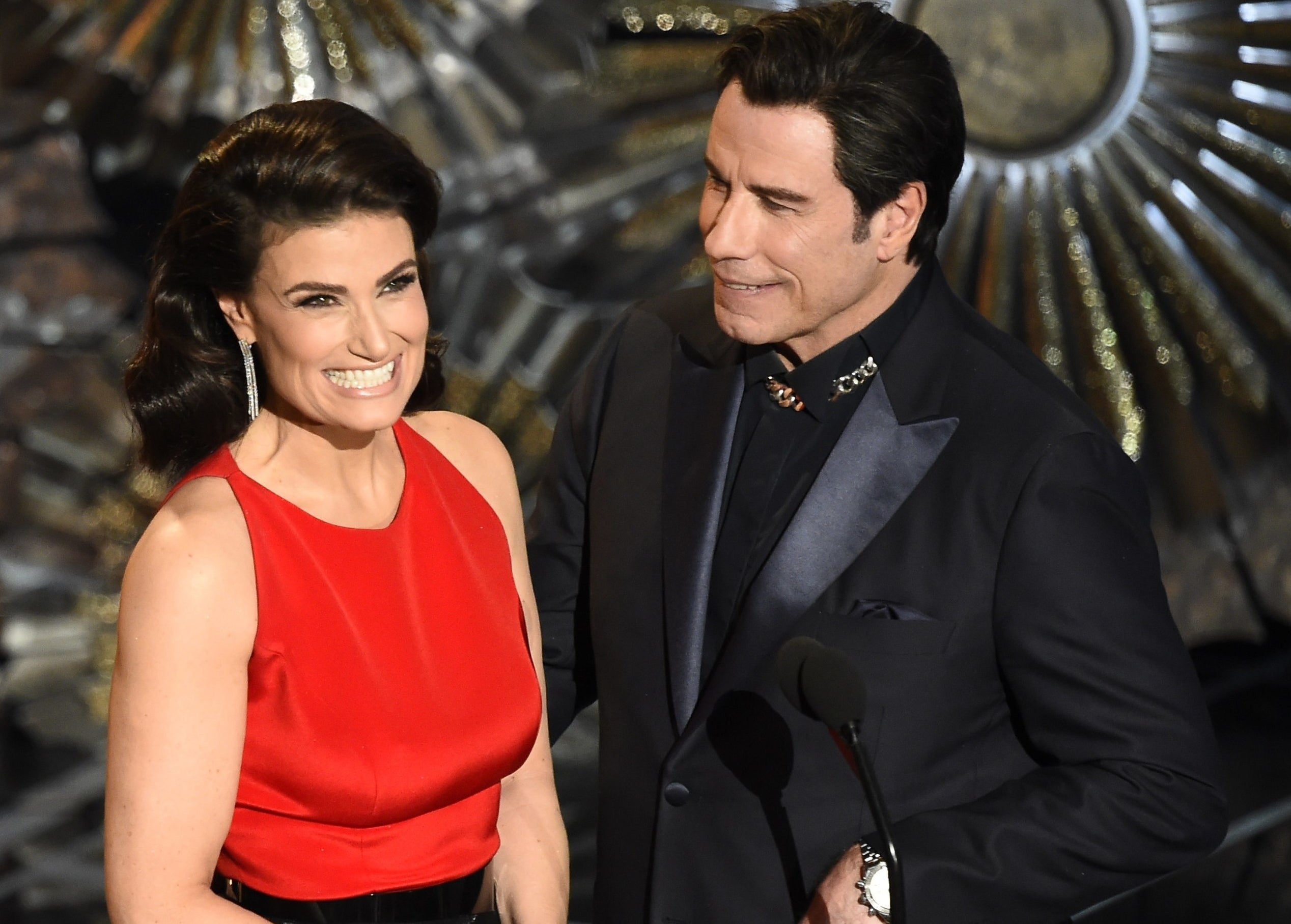 Idina and John smile while sharing the stage at a later time