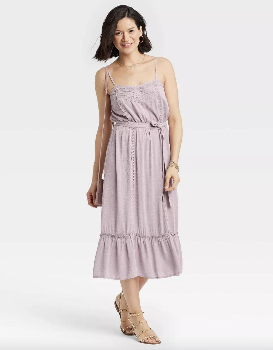 A woman wearing a purple tiered hem dress