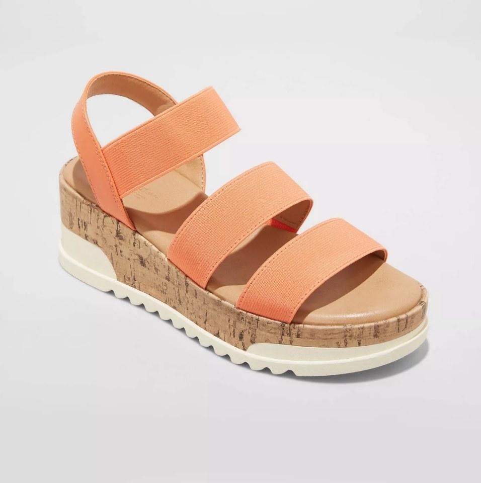 Platform sandal with cork platform, white sole, and orange foot straps