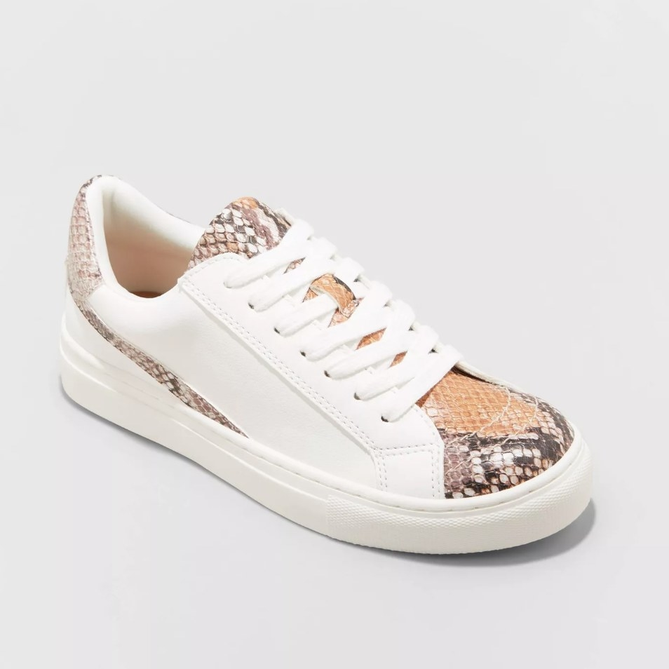 White sneaker with textured snake print detailing