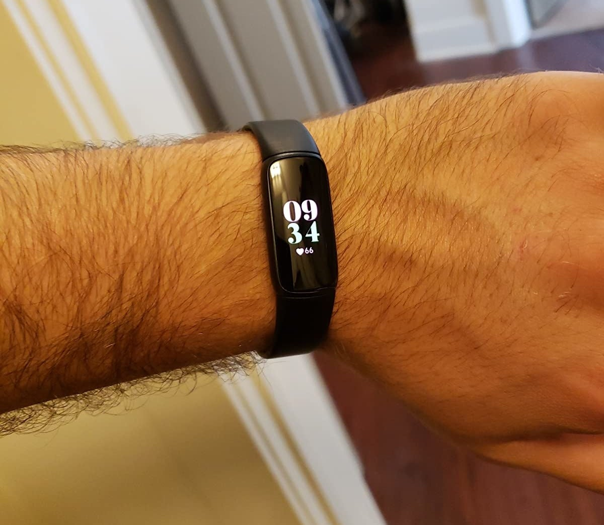 a reviewer's wrist wearing the FitBit