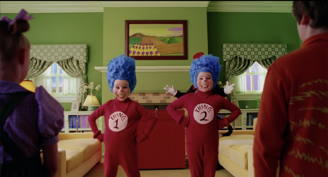Thing 1 and Thing 2, in red jumpsuits with blue hair