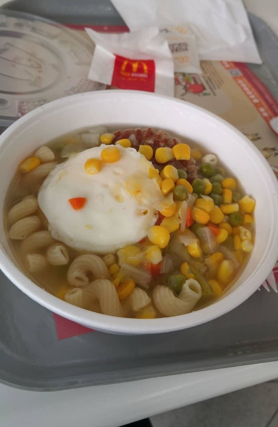 McDonald's breakfast soup with a poached egg.