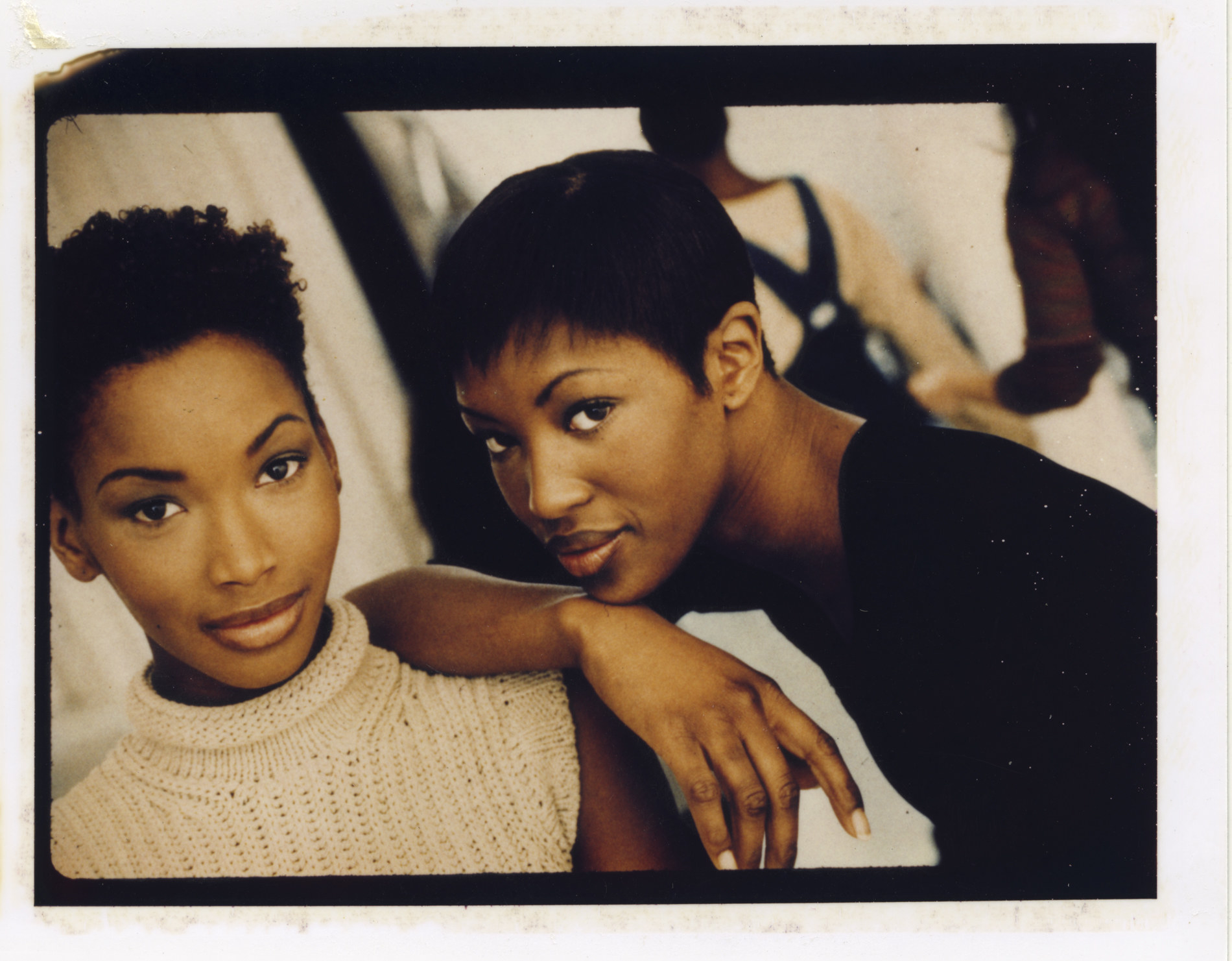 Beverly Peele and Naomi Campbell resting her head on Peele's shoulder, both looking at the camera