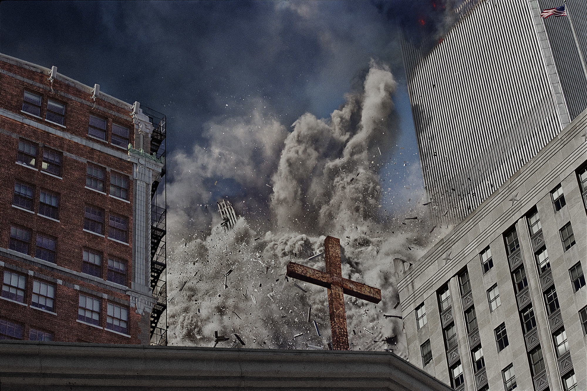 The debris from the first tower collapsing is seen behind a cross on a church
