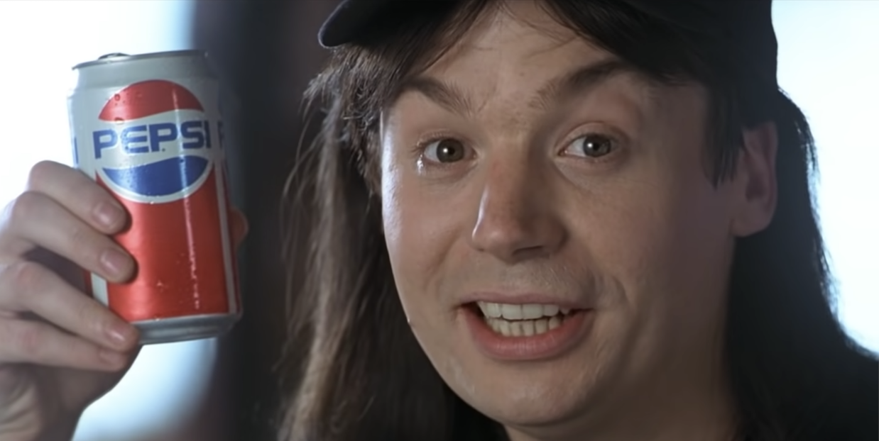 Mike Myers as Wayne holding up a pepsi can