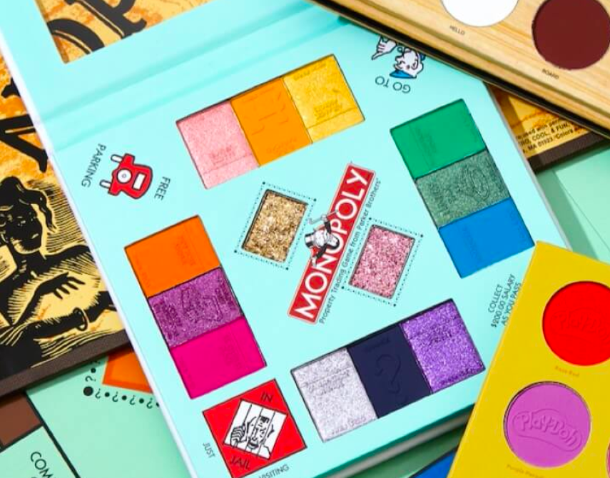 the palette s haped like the monopoly boards with shadows placed according to the colors form the game