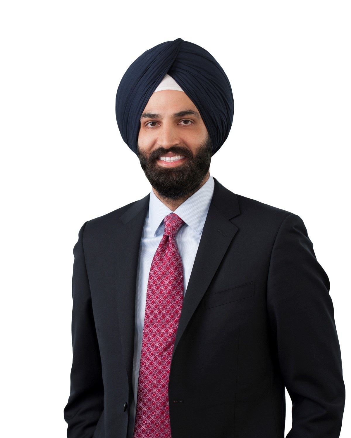 Amandeep in a work photo for his law firm