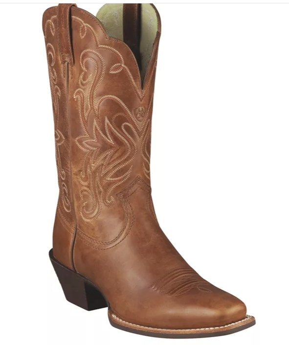 A brown leather boot with a heel