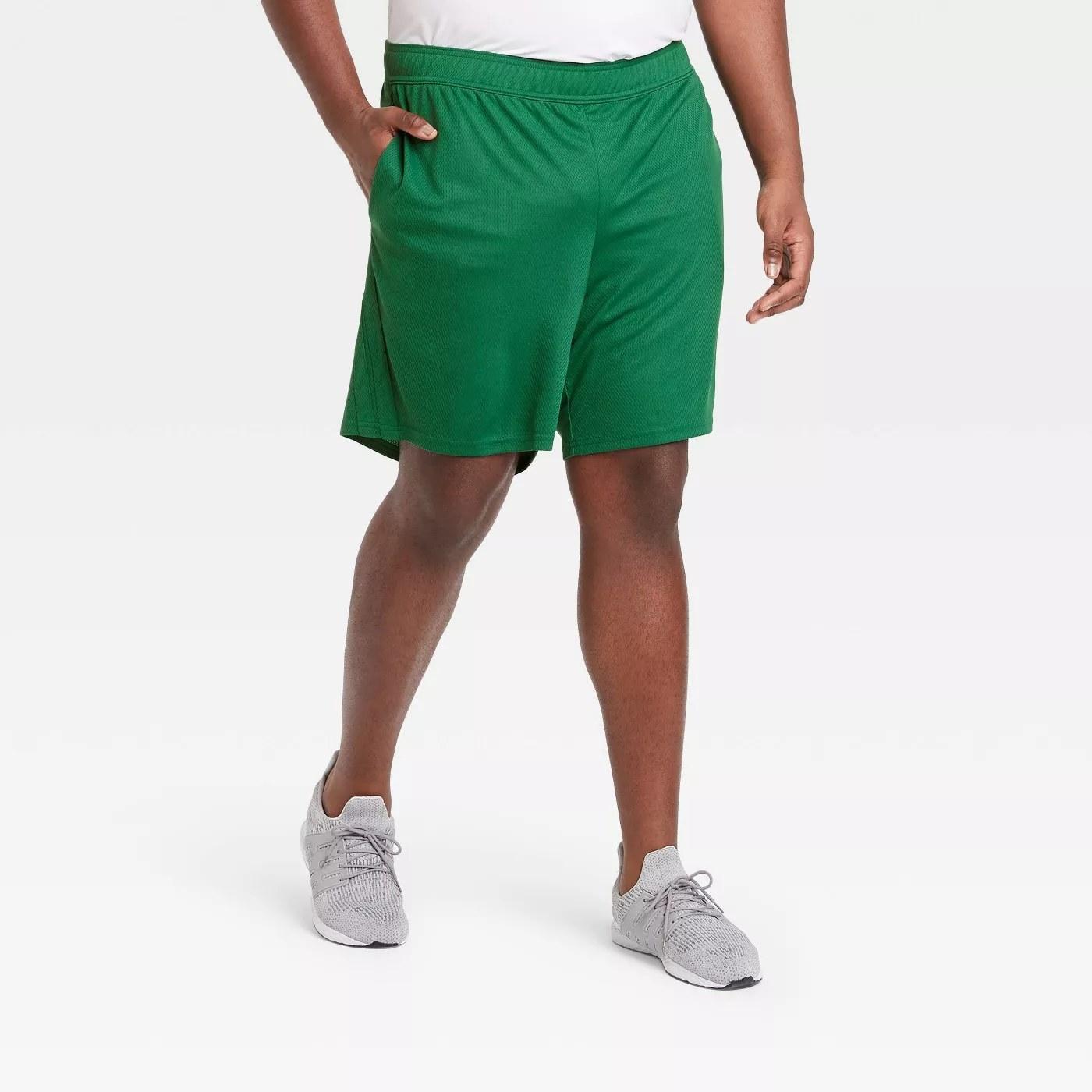 A green pair of basketball shorts