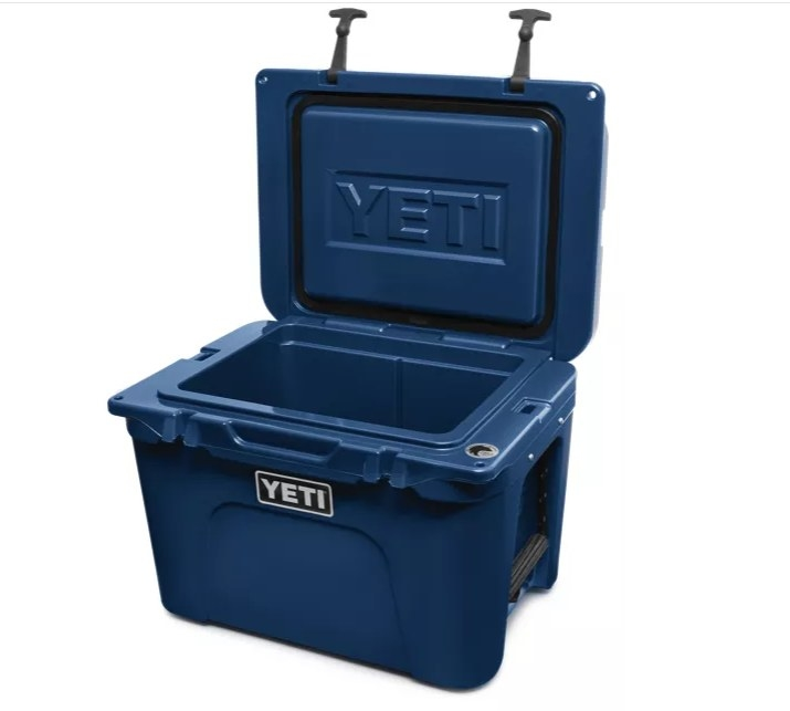 A blue cooler with the lid open