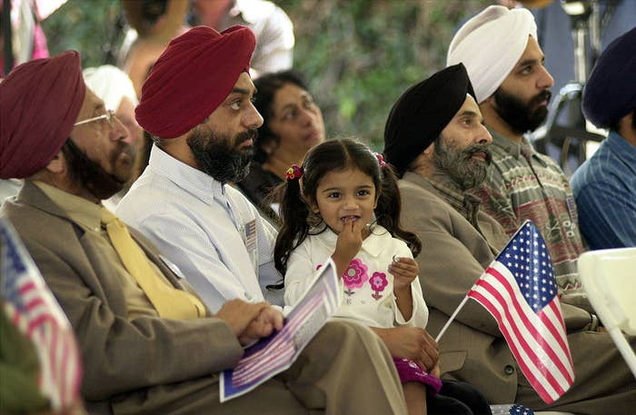 In this photo, I was almost 3 years old, sitting in my father's lap at a 9/11 memorial.