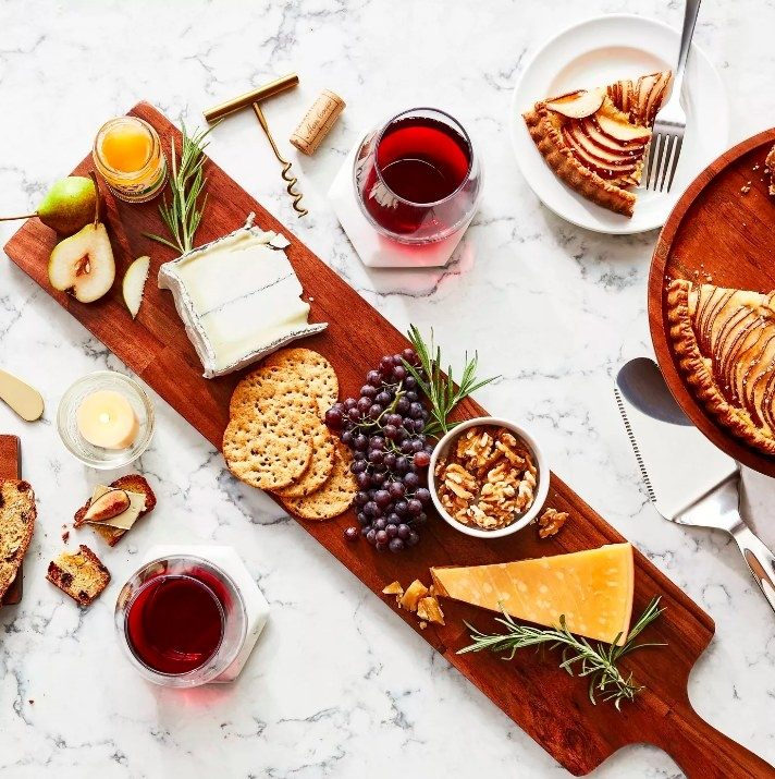 The cheese board used to serve a charcuterie spread