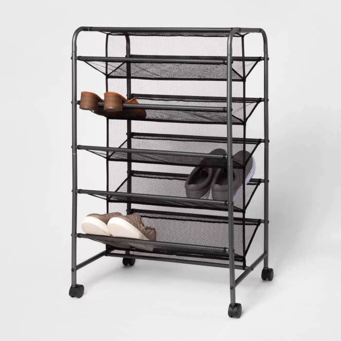 The shoe rack with a few pairs of shoes on it