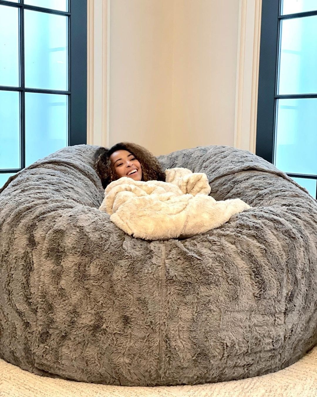 a model comfortably sitting in the middle of the lovesac