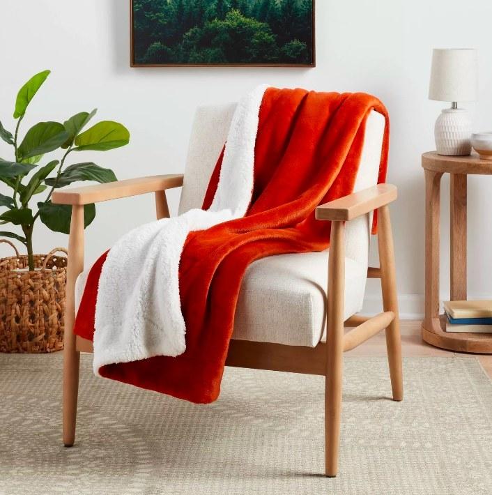 The orange throw blanket
