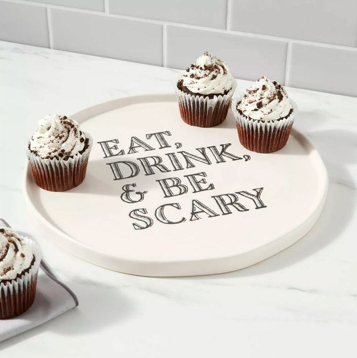 The stone platter serving mini chocolate cupcakes