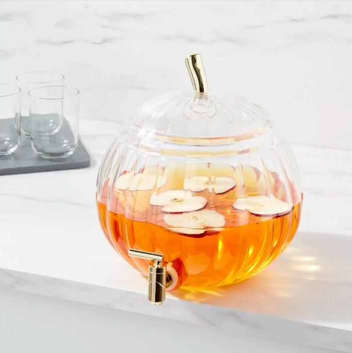 The pumpkin dispenser filled with apple cider