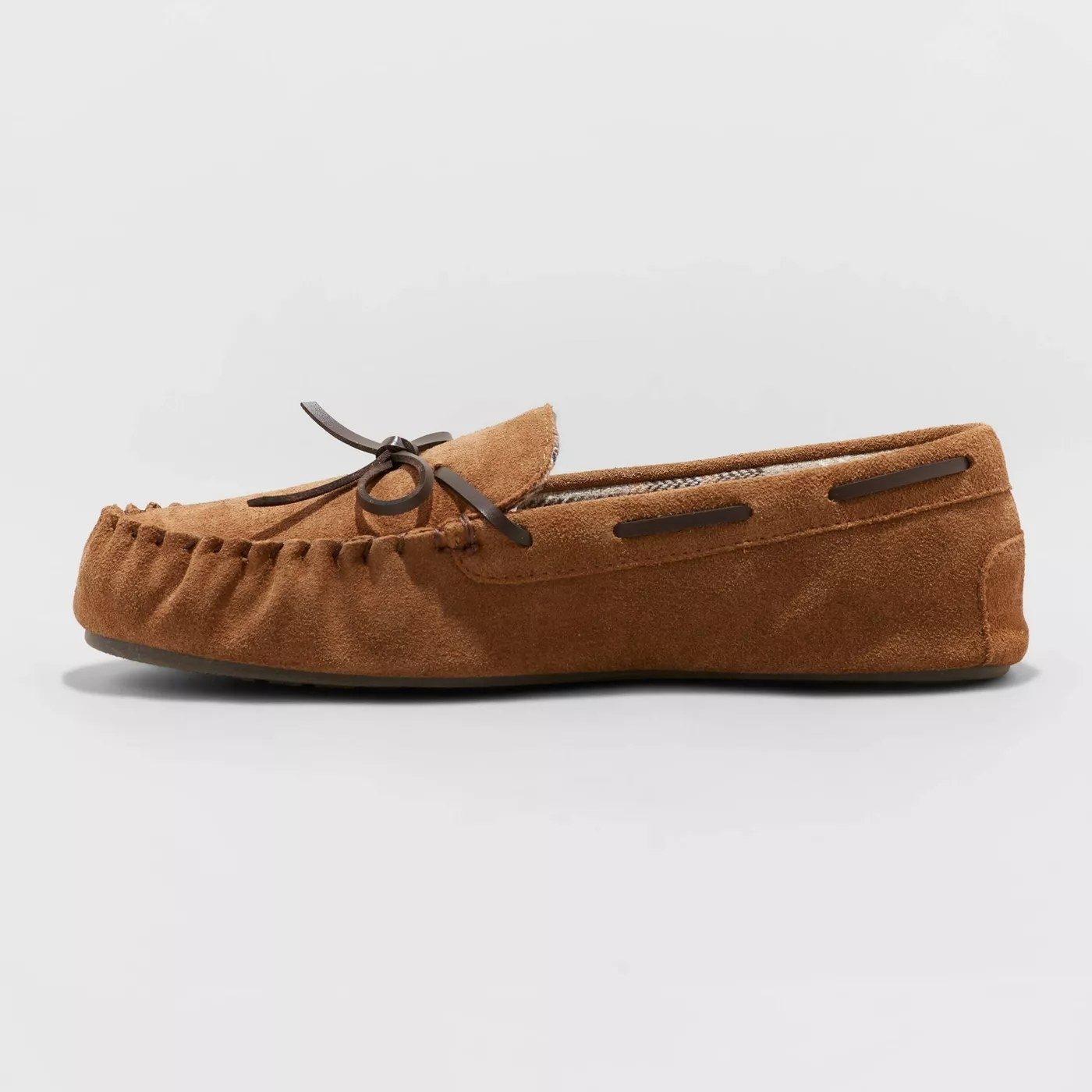 A moccasin slipper with leather laces