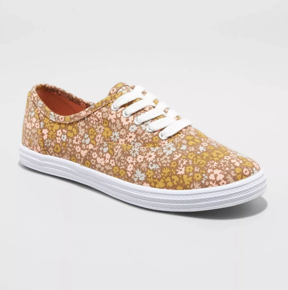 Brown, yellow, blue, and pink floral design sneaker with white laces and sole