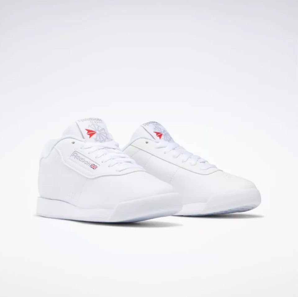 White reebok sneakers with red logo