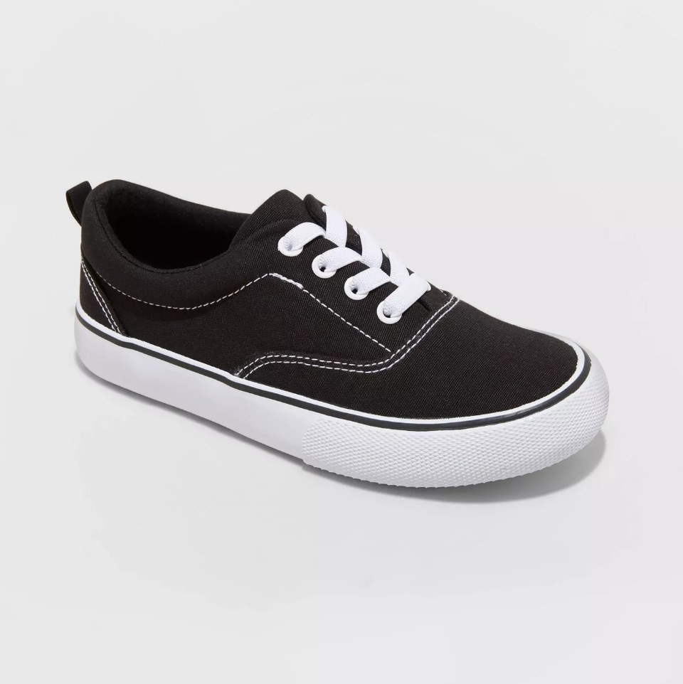 Black slip on sneaker with white detailing and white soul
