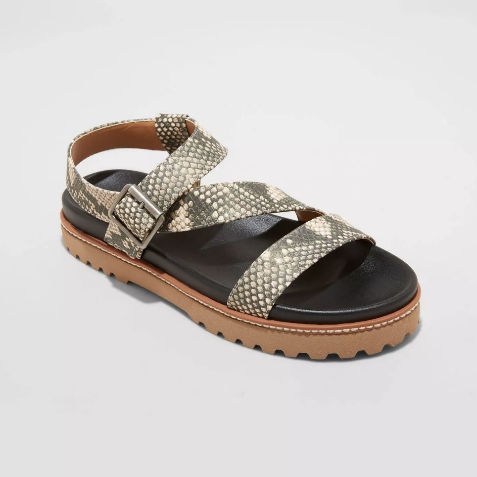 Sandal with snake skin straps, black insole and brown sole