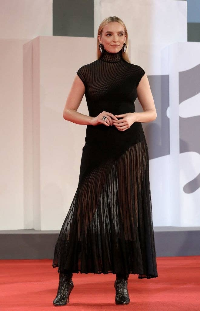 """Jodie Comer attends the red carpet of the movie """"The Last Duel"""" in a sheer black high neck gown"""