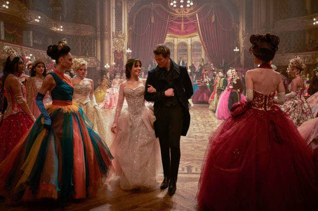 Cinderella being escorted by a man at a ball