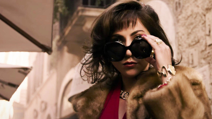 Lady Gaga looking over her sunglasses in a scene from House of Gucci
