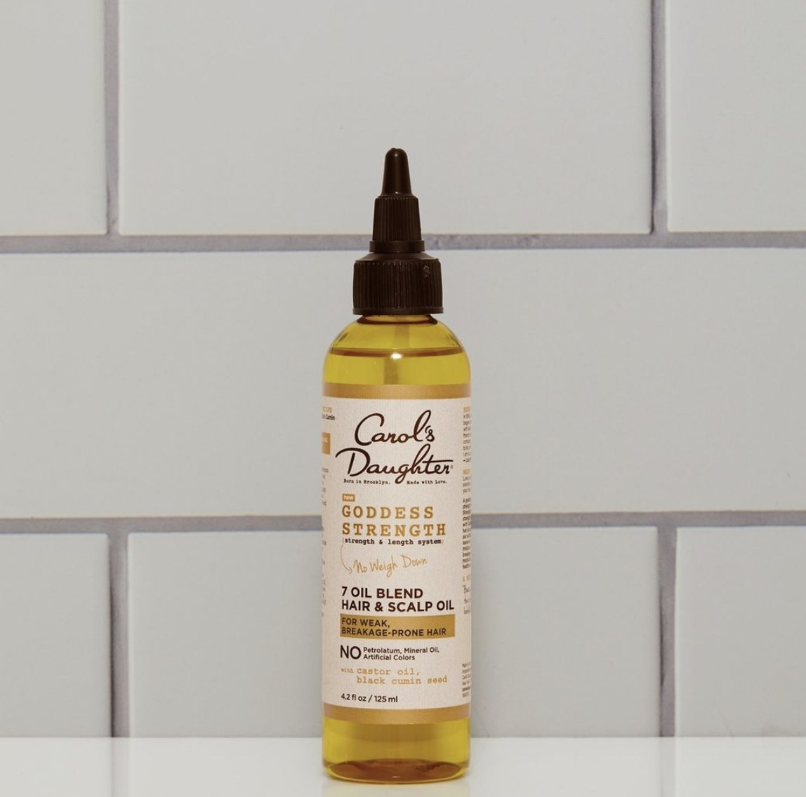 A bottle of scalp and hair oil