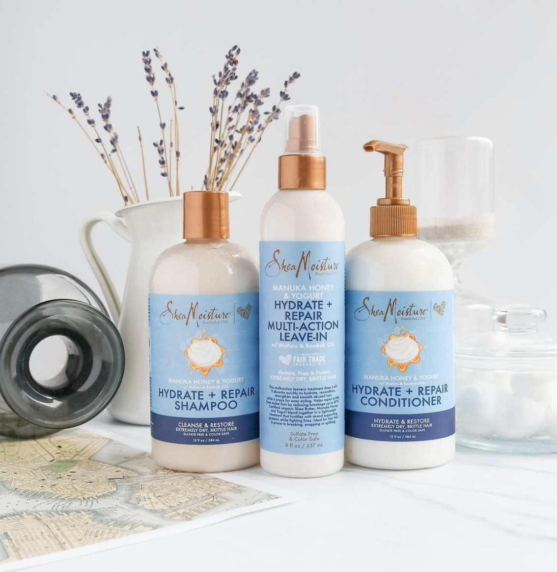 A set of shampoo, conditioner, and leave-in conditioner