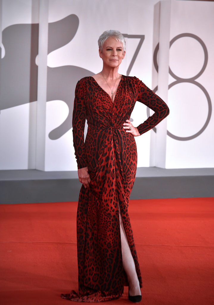 Jamie Lee Curtis at the Halloween Kills red carpet in a red leopard print gown