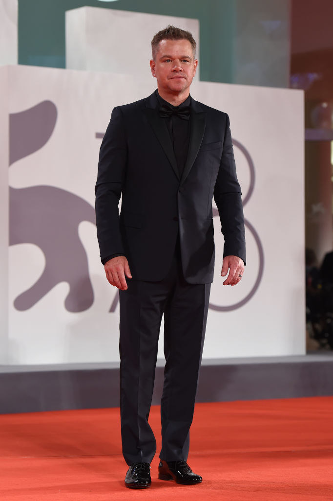 """Matt Damon attends the red carpet of the movie """"The Last Duel"""" in an all-black tux"""