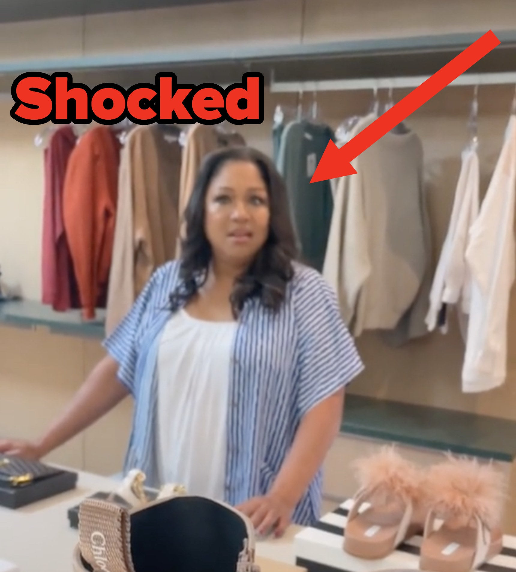 Lizzo's mom standing in the closet looking shocked