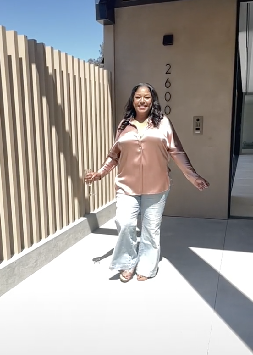 Lizzo's mom smiling outdoors