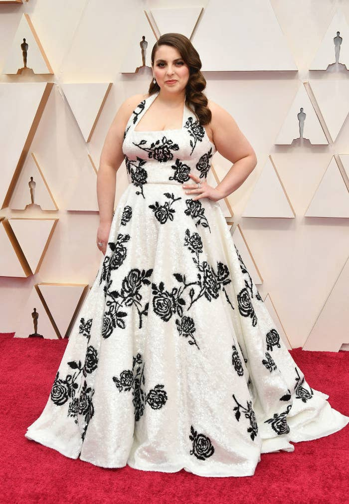 Beanie at the 2020 Oscars wearing a white Miu Miu gown adorned with black rose detailing