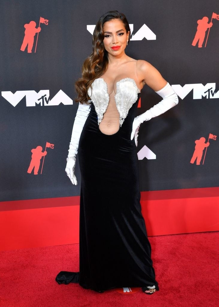 Anitta on the red carpet in a black velvet gown with silver accents around the bust